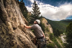 Man sport climbing in Clear Creek Canyon, Colorado