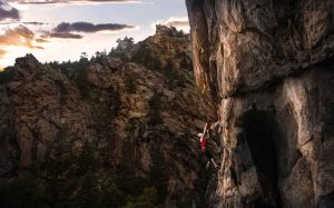 Woman climbing overhung route during sunset in Clear Creek Canyon, Colorado