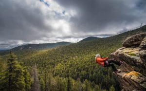 Woman rappelling near Conifer, Colorado