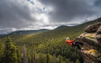 Woman rappelling near Conifer, Colorado