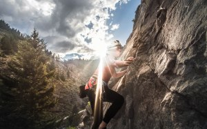 Woman climbing at sunset climbing in Clear Creek Canyon, Colorado