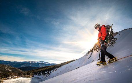 Man descending with crampons down St. Mary's Glacier, Colorado