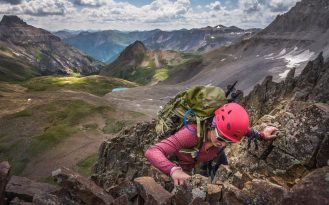 Woman climbing in Sneffels Wilderness, Colorado