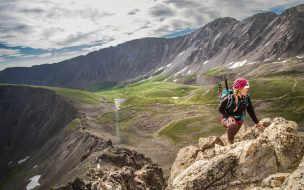 Woman climbing Kelso Ridge, Colorado