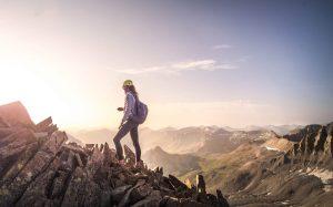 Woman sunrise scrambling over Mt. Sneffels, Colorado